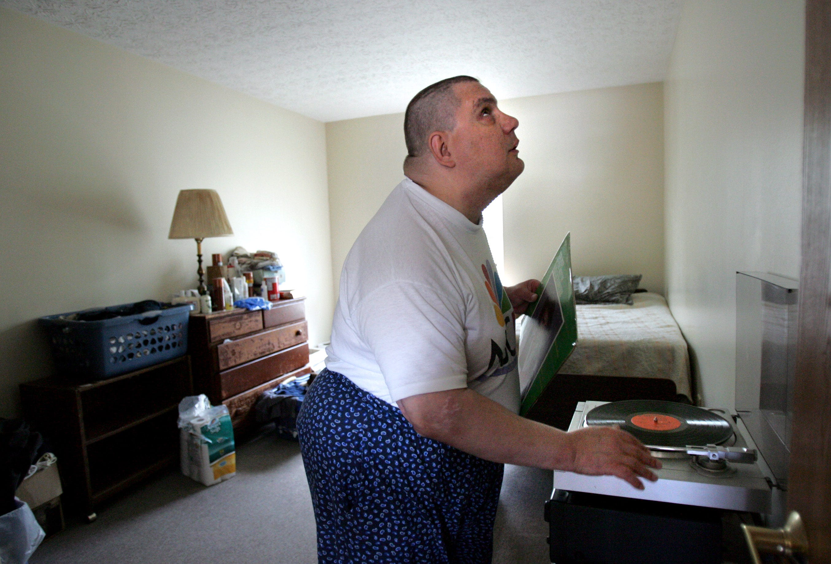 In Columbus, Ohio, officials lead an effort to build safe housing for those with mental illness. In this photo from 2006, Jim Kline — who is blind, has schizophrenia and suffers from a variety of physical ailments — was able to live on his own through the Community Housing Network. He particularly liked the ability to play his own music.