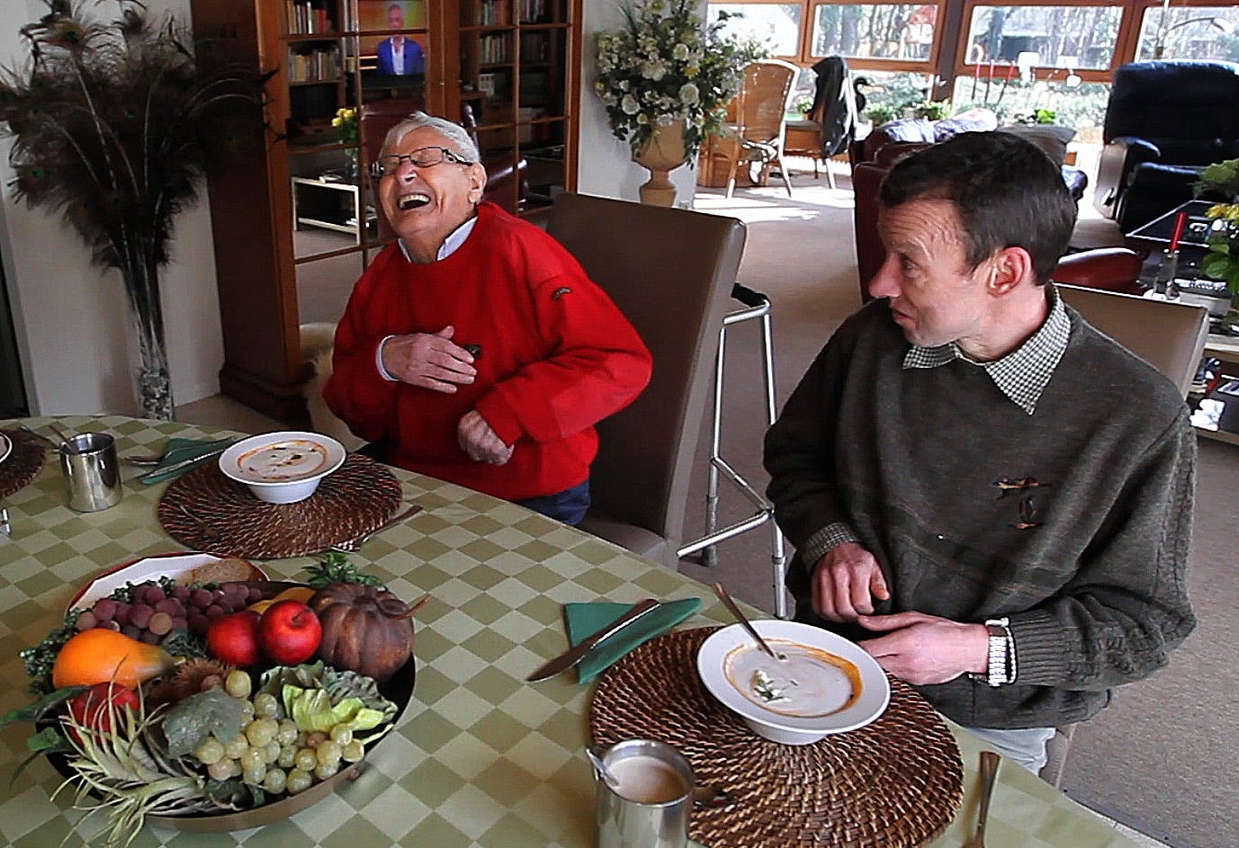 Like brothers, Dis, left, and Luc joke around during lunch at their home in Geel, Belgium. January 25, 2013.