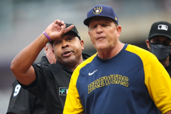 Milwaukee Brewers bench coach Pat Murphy reacts to umpire Adrian Johnson after exchanging lineups with the Minnesota Twins before the start of Saturday's game at Target Field. He was ejected after expressing his unhappiness with the performance of the home-plate umpire on Friday night.