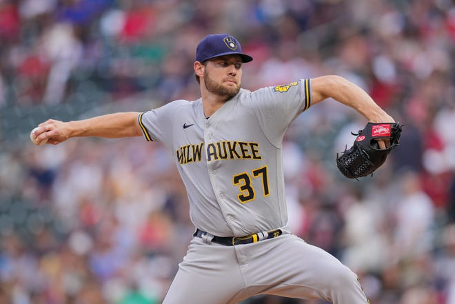 Brewers starting pitcher Adrian Houser delivers against the Minnesota Twins in the first inning at Target Field.
