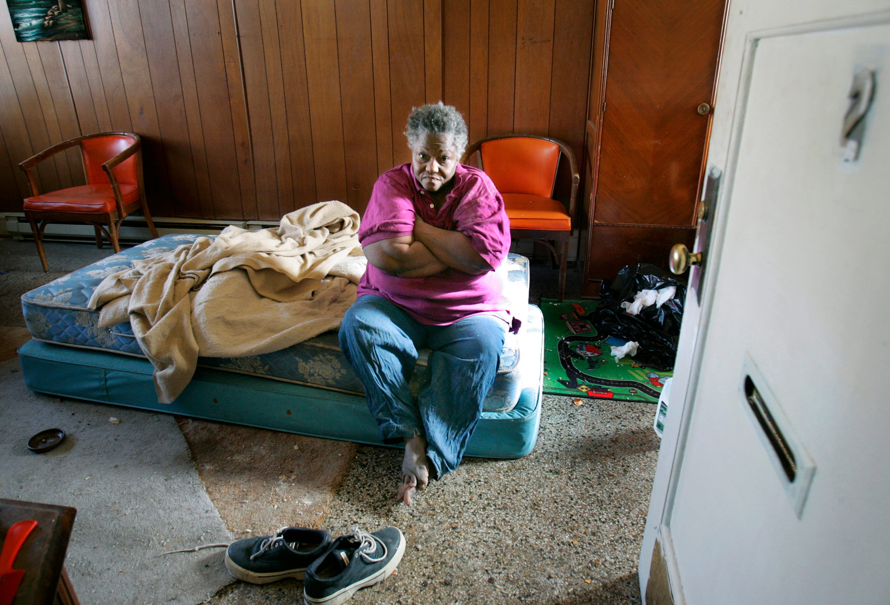 In 2006, a Journal Sentinel investigation revealed dangerous and deadly conditions for hundreds of people with mental illness. In this 2006 photo, Bessie Johnson sits on a bare mattress soaked in her own urine at a boarding house in Milwaukee.