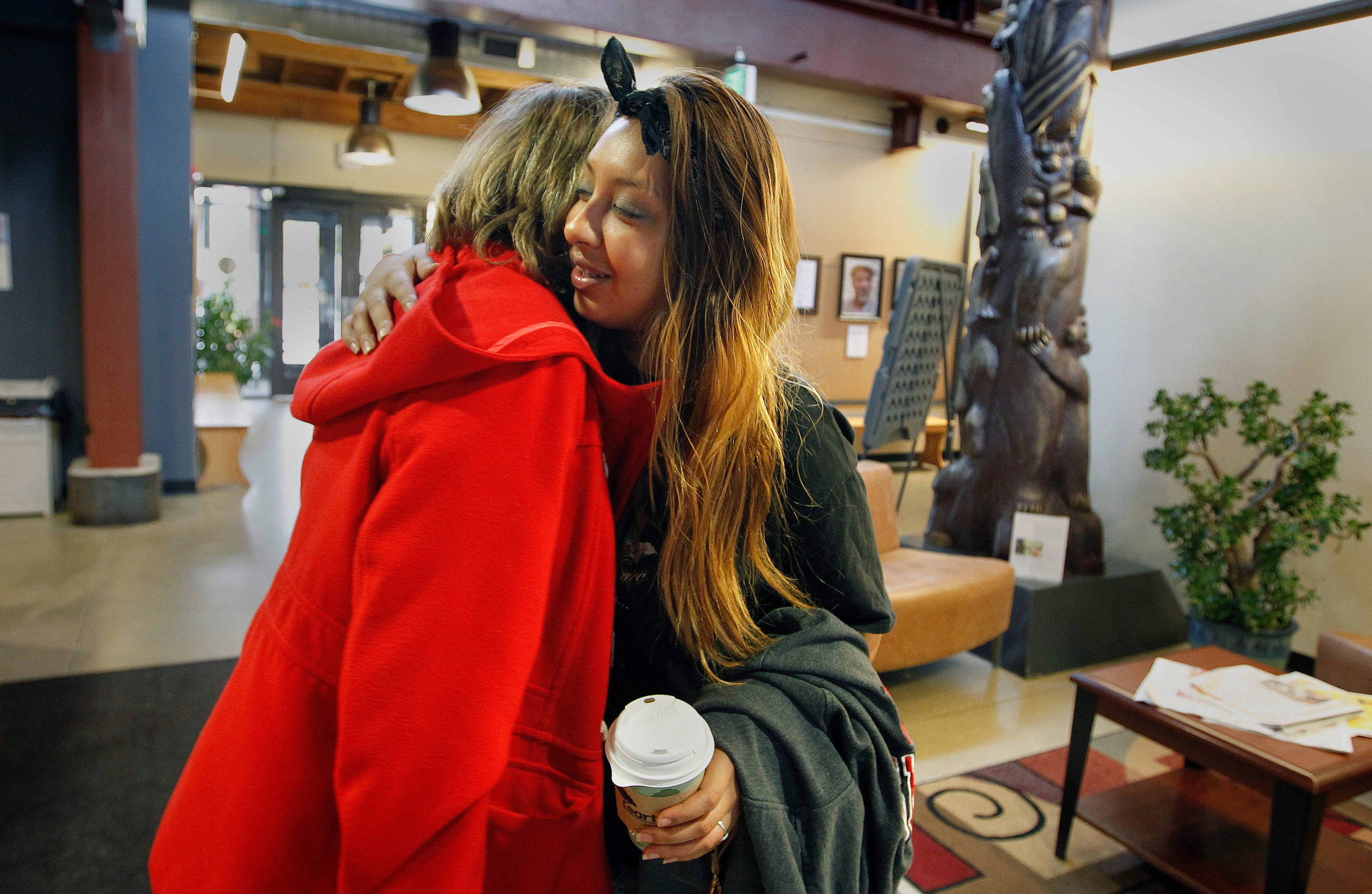 Madison pioneered the Assertive Community Treatment model in which teams provide support in the community for those dealing with mental illness. Team member Barbara Culver, left, hugs a Kiara, a client, after a visit on a recent morning.
