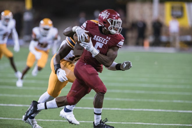 O'Maury Samuels (5) runs the ball as the New Mexico State Aggies face off against the UTEP Miners at Aggie Memorial Stadium in Las Cruces on Saturday, Aug. 28, 2021.