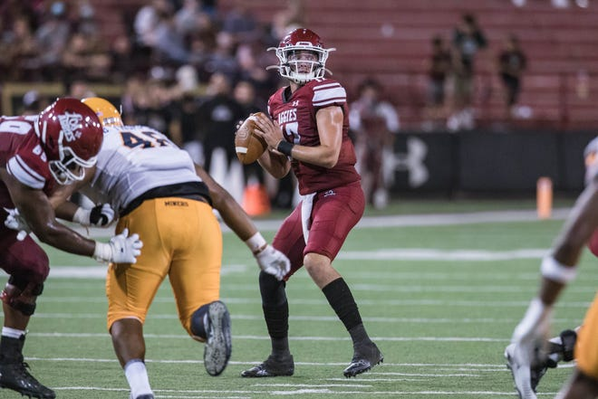 Weston Eget (17) looks to pass as the New Mexico State Aggies face off against the UTEP Miners at Aggie Memorial Stadium in Las Cruces on Saturday, Aug. 28, 2021.