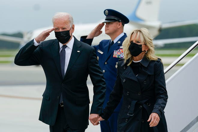 President Joe Biden returns a salute as he and first lady Jill Biden arrive at Dover Air Force Base, Del., Sunday, Aug. 29, 2021.