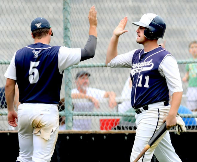 East Prospect's Ryky Smith (11) is congratulated after scoring by teammate Austin Denlinger against Hallam in Game 4 of the Susquehanna League Baseball Playoff Championship Series at Spry Sunday, Aug. 29, 2021. Bill Kalina photo