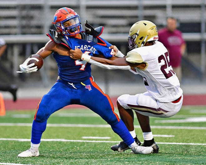 York High's Jaheim White, left, gets pulled down by Governor Mifflin during football action at Smalls Athletic Field in York City, Saturday, Aug. 28, 2021. Governor Mifflin would win the game 55-6. Dawn J. Sagert photo