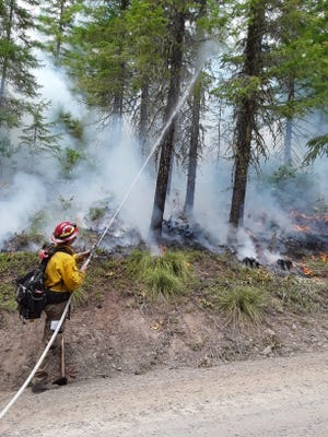 """Smoke from the Bull Complex Fire burning north of Detroitsettled along theSantiam Canyon overnight making the air quality """"unhealthy."""" And fire officials say the smoke willlikely linger through Sunday."""