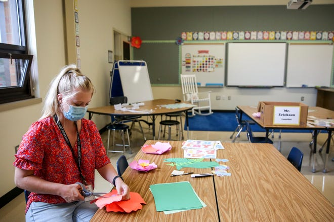 First-grade teacher Sydney Martindale decorates her classroom before the start of the school year on Thursday, Aug. 26, 2021, at Ch‡vez Elementary School in Salem, Ore.