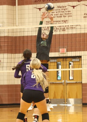 Harper High School volleyball player Talli Millican (20) attempts to block a shot by Benjamin during a match at the Bronte Showdown Saturday, Aug. 28, 2021, at Bronte High School.