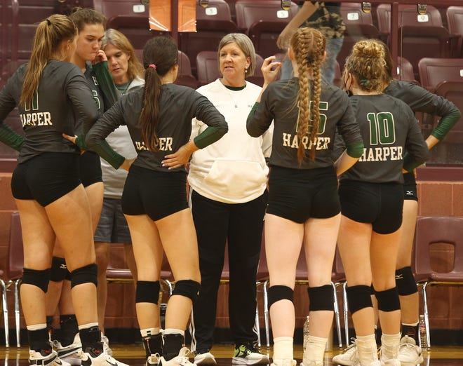 Harper High School head volleyball coach Gina Lumpkins has a timeout with her team during a match at the Bronte Showdown Saturday, Aug. 28, 2021, at Bronte High School.