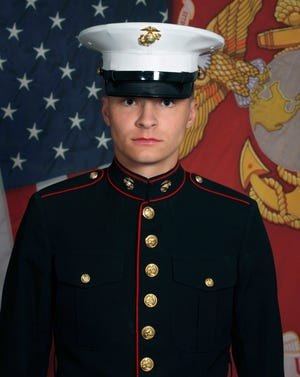 This undated photo released by the 1st Marine Division, Camp Pendleton/U.S. Marines shows Marine Corps Cpl. Daegan W. Page, 23, of Omaha, Neb.