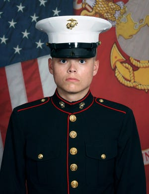 This undated photo released by the 1st Marine Division, Camp Pendleton/U.S. Marines shows Marine Corps Lance Cpl. Jared M. Schmitz, 20, of St. Charles, Missouri.