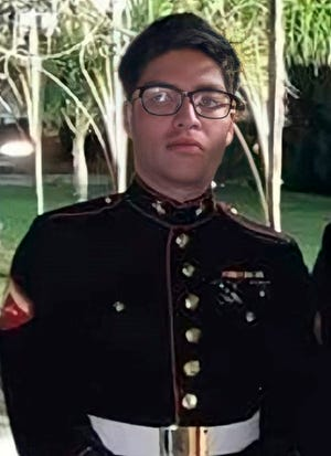 This undated photo released by the 1st Marine Division, Camp Pendleton/U.S. Marines shows Marine Corps Cpl. Humberto A. Sanchez, 22, of Logansport, Indiana. Eleven Marines, one Navy sailor and one Army soldier were among the dead, while 18 other U.S. service members were wounded in Thursday Aug. 26, bombing, which was blamed on Afghanistan's offshoot of the Islamic State group. (U.S. Marines via AP)