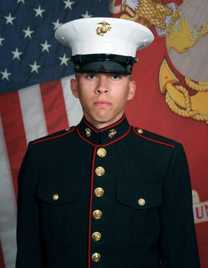 This undated photo released by the 1st Marine Division, Camp Pendleton/U.S. Marines shows Marine Corps Lance Cpl. Dylan R. Merola, 20, of Rancho Cucamonga, Calif.