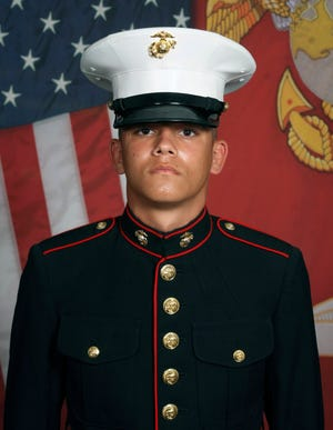 This undated photo released by the 1st Marine Division, Camp Pendleton/U.S. Marines shows Marine Corps Lance Cpl. Kareem M. Nikoui, 20, of Norco, Calif.