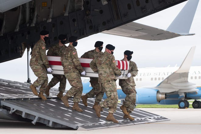 A transfer case with the remains of Army Staff Sgt. Ryan C. Knauss, 23, of Corryton, Tennessee, are carried off of a military aircraft Aug. 29, 2021, at Dover Air Force Base in Dover, Delaware. The Cumberland County community is planning a vigil to honor the life of Knauss and 12 other service members who died in Afghanistan last week.