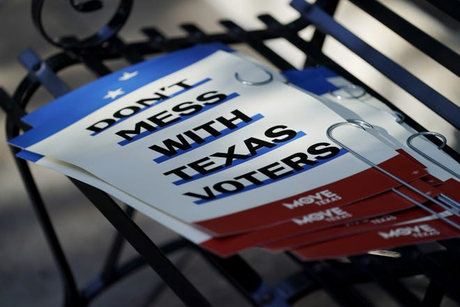 Signs protesting proposed voting legislation sit on a bench outside the Texas Capitol in Austin on Aug. 23. [AP PHOTO/ERIC GAY]