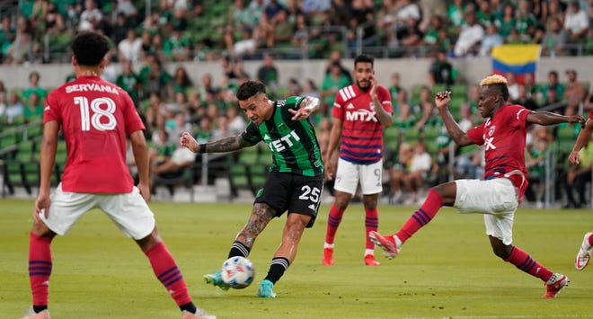 Austin FC midfielder Sebastián Driussi shoots on goal as FC Dallas midfielder Jader Obrian defends during Austin's 5-3 loss Sunday at Q2 Stadium. Driussi had one assist in the setback.