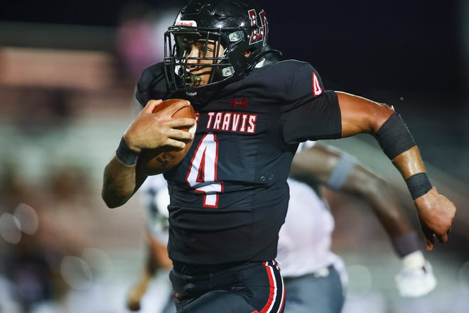 Lake Travis' DJ Johnson, running for a touchdown against Arlington Martin, was a force on both sides of the ball, contributing 234 yards of total offense, four solo tackles and a fumble recovery to earn player of the week honors.