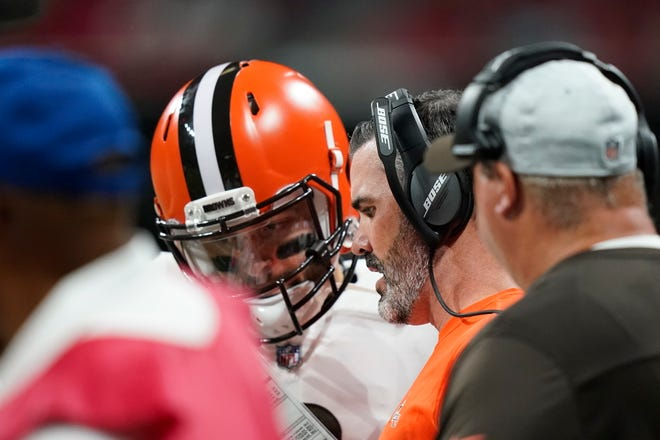 Browns coach Kevin Stefanski talks with quarterback Baker Mayfield on the sideline during a preseason game against the Atlanta Falcons. [Brynn Anderson/Associated Press]