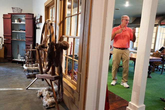 Tallmadge Historical Society President Chris Grimm gives a tour of the newly renovated Old Town Hall and Museum. The society recently spent $10,000 to replace the flooring and repaint the the walls on the second floor museum, and is spending $34,000 on exterior renovations.