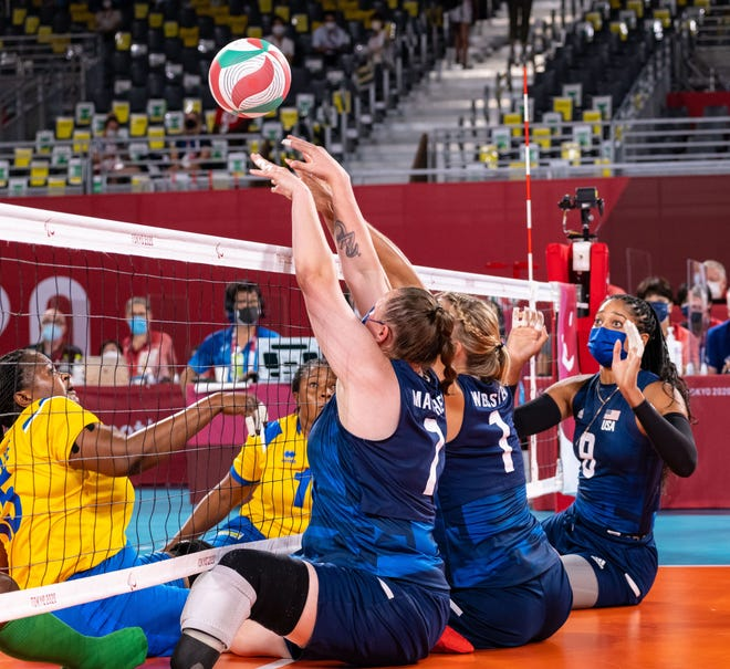 Ardmore native Monique Matthews (7) goes up for a block Monday against China. Matthews led all scorers with 11 points in the 3-0 loss.