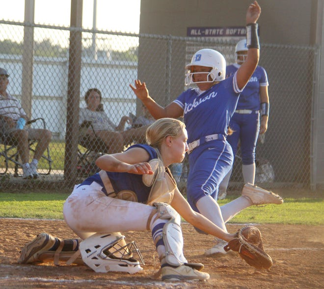 Dickson's Camie McGahey slides into home plate last week against Ringling. The senior, who finished with four RBIs in that game, is back with the Lady Comets after sitting out for the past two years.