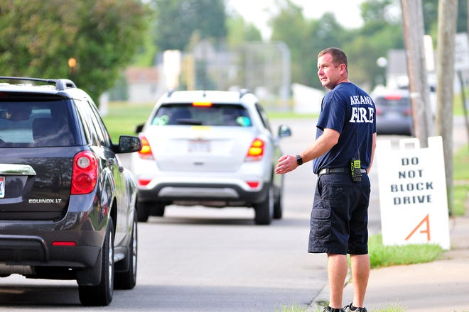Dan Robinson of the Ashland Fire Department helps with traffic during the first day of school for Ashland City Schools on Monday.