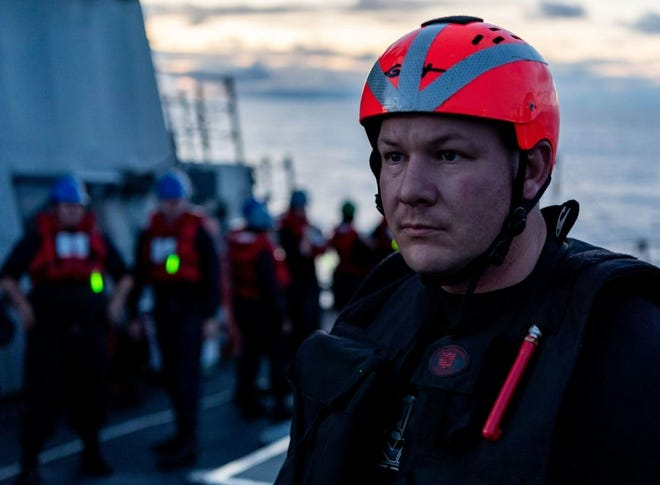 Pictured is Lippincott, who is also a search-and-rescue swimmer, preparing to get deployed during a man overboard drill aboard the USS O'Kane in June in the Pacific Ocean.
