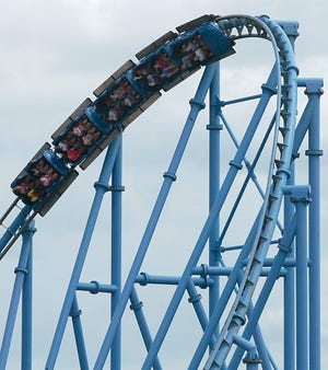 Riders on the Mr. Freeze roller coaster go into an inverted turn at Six Flags St. Louis in Eureka. The coaster takes riders from zero to 70 mph in just over four seconds.