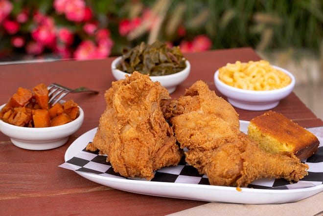 Three piece chicken dinner with greens, mac & cheese and yams at Modern Southern Table in the Budd Dairy Hall