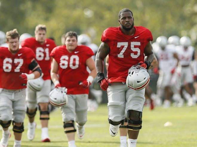 A position change looks to be in the works for Ohio State offensive lineman Thayer Munford, who would be making the move despite missing a portion of this fall's preseason camp.
