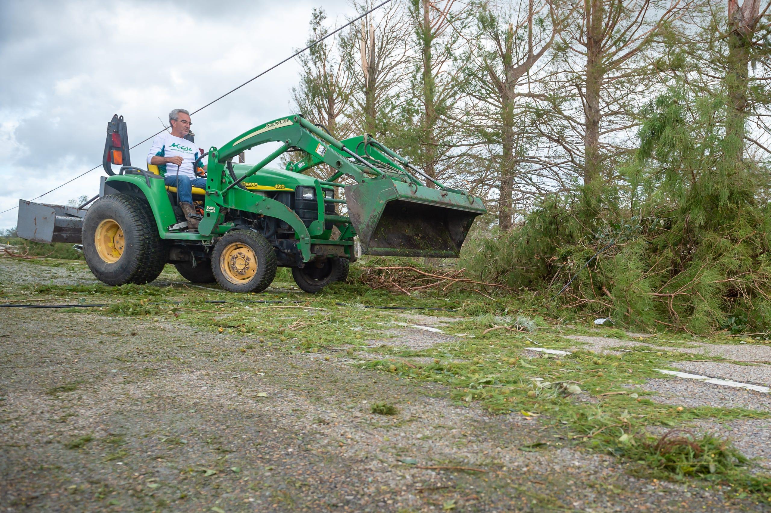 Robert Lirette clearing debris from roadway and neighbors yards after Hurricane Ida in Houma, LA. Monday, Aug. 30, 2021.