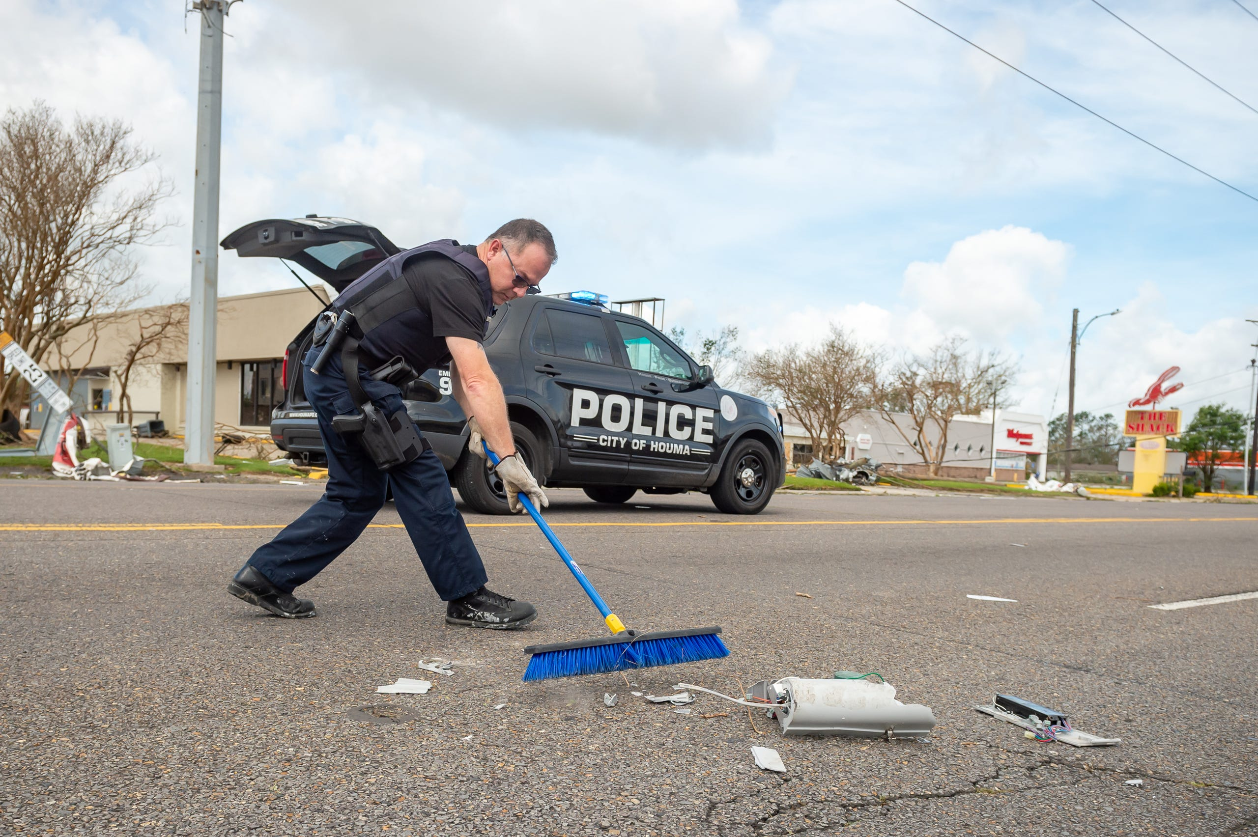 Officer Walter Tenney clearing debris from roadway after Hurricane Ida in Houma, LA. Monday, Aug. 30, 2021.