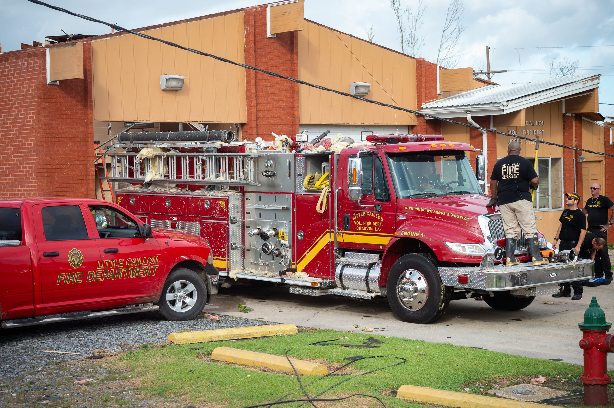 Firefighters work to remove truck from fire station in Little Callou after roof was blown off of the fire station by Hurricane Ida. Monday, Aug. 30, 2021.