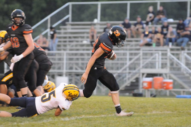 Hudson's Nick Kopin runs the ball during Thursday's game against Ithaca.