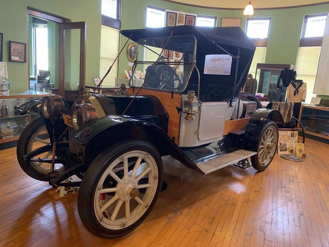 """The 1912 Lion 40, pictured, is on display at the Lenawee Historical Museum. The car was donated to the museum in 2001 by William and Paul """"Pete"""" Saunders. The vehicle had to be taken apart and brought into the museum in pieces, where it was reassembled by Adrian fleet mechanic Nick DuShane, Jim Scott of Hunter's Moving, Murray Paige and other volunteers from the Irish Hills Antique Car Club."""