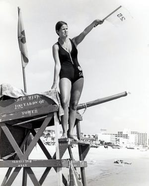 """Laura Sherrill, Daytona's first female lifeguard, in the summer of 1974. """"My first day at the tower, I felt as if I was on exhibition. People kept coming up and just looking at me for the first two days, but now most are accepting it,"""" she told The Daytona Beach Evening News."""