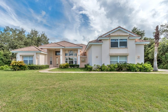Situated on almost an acre, this exclusive pool home is nestled in the Port Orange gated community of The Sanctuary at Spruce Creek.
