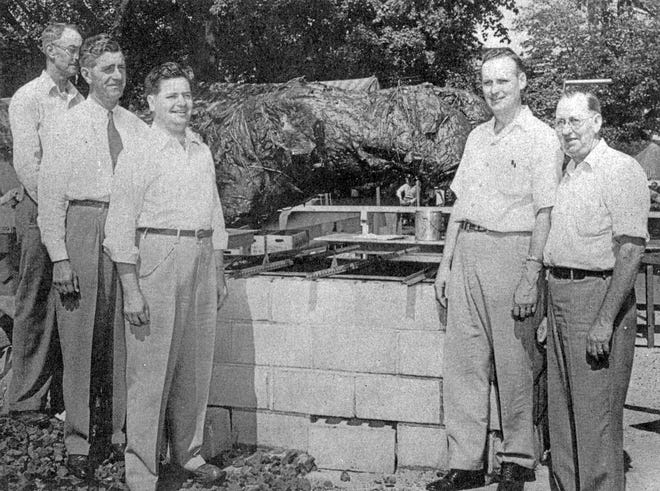 """Bob Albert—the father of the Prime Beef Festival—stands third from left in this photo from the 1948 festival, in which a 1,200 pound steer was one of three roasted on the Public Square. Also pictured, from left, are John Hillen, Dr. O.E. Sterett, """"Oly"""" Keister and Mayor Guy Pearson."""