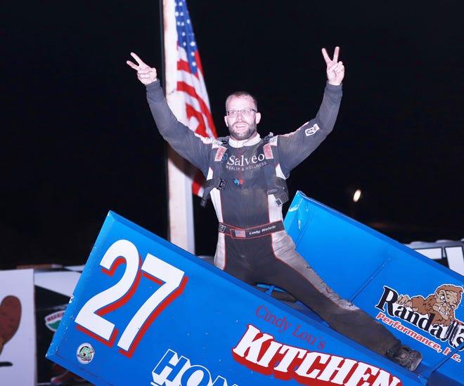 Burlington's Cody Wehrle celebrates his feature win and season championship Saturday at 34 Raceway.
