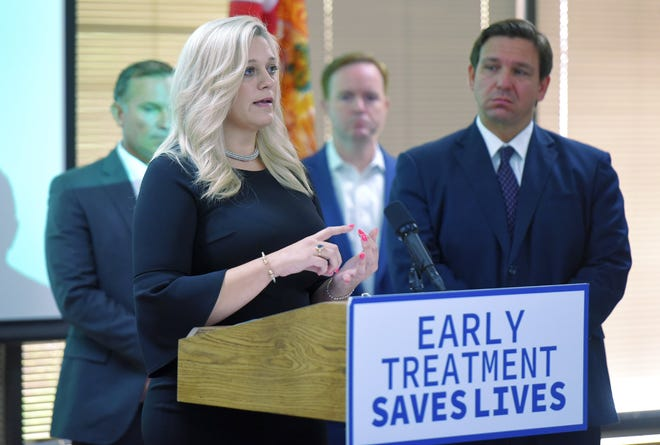 Toma Dean was the Fleming Island woman seen in a recent viral photo laying on the floor of the Jacksonville Regeneron clinic as she awaited treatment. During an appearance Monday with Gov. Ron DeSantis, she urged other people with COVID-19 to get the treatment.