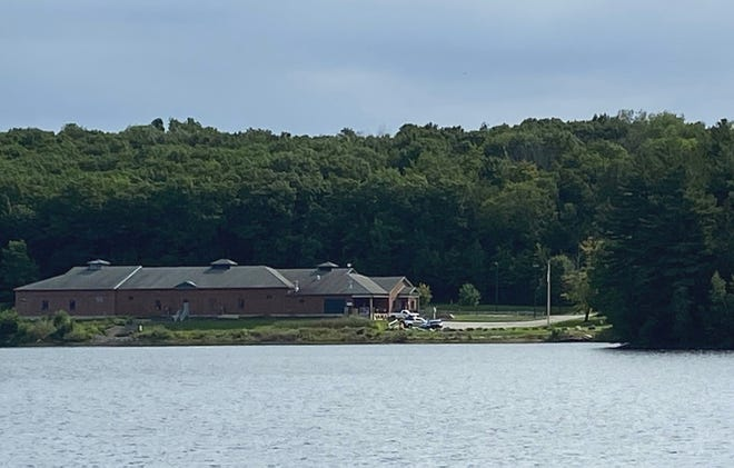 Looking across Crystal Lake to the Gardner Pumping Station and a former location of the Gardner Boat Club.