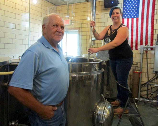 """Jerry Snodgrass, president of the Maple City Cruisers; watches as Rachel Leiby, head brewer at Geneseo Brewing Company, begins creating a new beer, """"Maple City Cruisers,"""" in honor of the 15th anniversary of the club's car show being held in conjunction with the Trains, Planes & Automobiles celebration Sept. 9-11 in Geneseo. All proceeds from the sale of the beer will benefit Abilities Plus in Kewanee. The beer will be available to purchase beginning this weekend."""