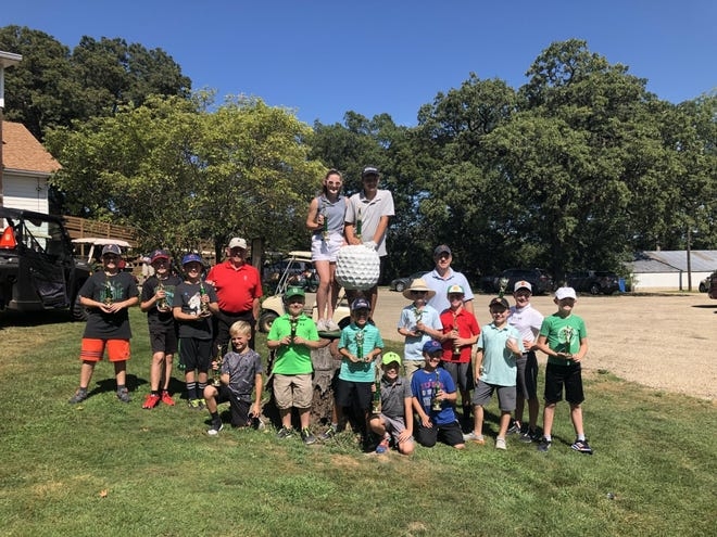 Young people ranging in age from 7 to 13 took part in the recent Andrews Golf Tournament at Geneseo County Club. The photo shows participants and volunteers in the golf tournament, front from left, Gavin Galloway, Cooper Vorac, Harrison Vorac, Carver Allen, Justin Roemer; second row, Raidyn Allison, Gavin Gillespie, Colin Roemer, Kyle Wirth, Duncan Reed, Hudson Vorac, Trace Hager, Declan Gillespie; in back, Jim Andrews, who founded golf etiquette clinic held in conjunction with the tournament; Katy Wilson and Hayden Schaaf, on stump; and Ryan Gillespie, Ryan Gillespie, volunteer who now is in charge of the tournament