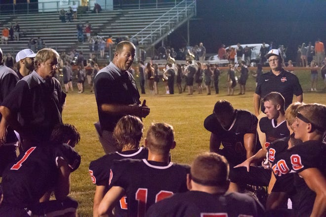 Jonesville head coach Frank Keller talks to the team after their Friday night victory over the Hillsdale Hornets.