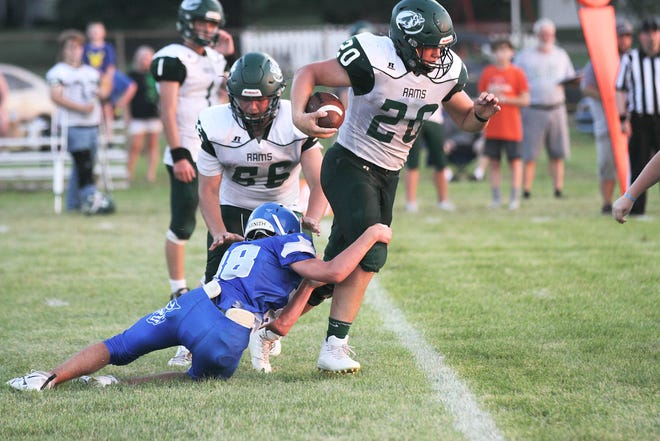NA-J's Cody Newell (20) breaks through a tackle during their Friday night victory over Burr Oak.