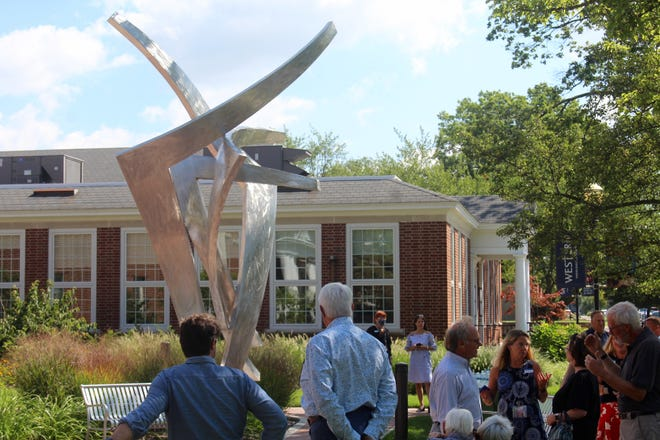 """Around 50 people gathered for the public unveiling of """"Glory"""" at Western Theological Seminary in Holland Monday, Aug. 30."""