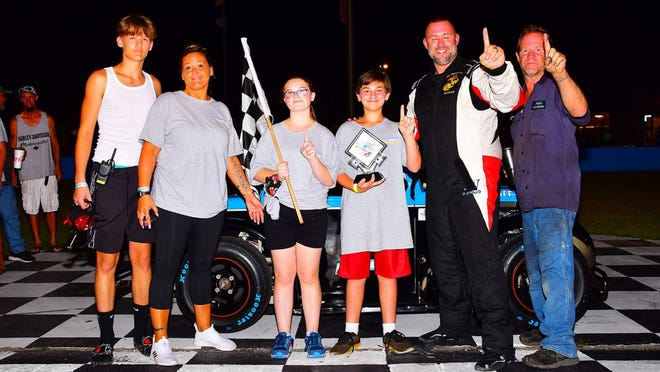 D.J. Murphy celebrates in victory lane with friends and family after scoring his first career win at Goodyear All American Speedway on Saturday.